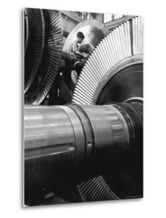Workman on Large Wheel That Looks Like Fan, at General Electric Laboratory-Alfred Eisenstaedt-Metal Print