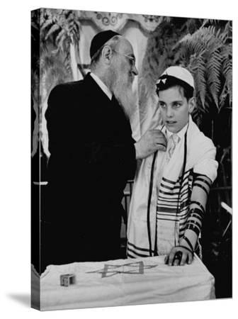 Rabbi David S. Novoseller Adjusting Carl Jay Bodek's Robe During Ceremony-Lisa Larsen-Stretched Canvas Print