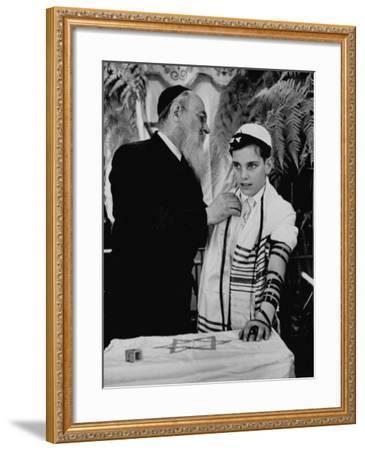 Rabbi David S. Novoseller Adjusting Carl Jay Bodek's Robe During Ceremony-Lisa Larsen-Framed Photographic Print
