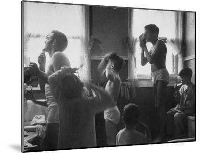 Professional Couple's Big Family, Sharing the Only Bathroom, Early in the  Morning Photographic Print by Gordon Parks | Art com