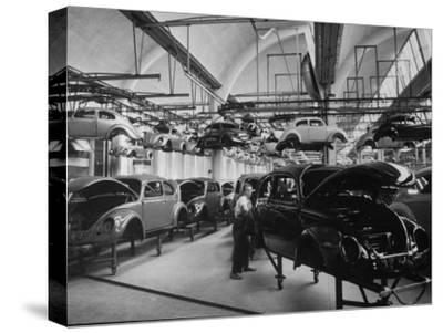 Volkswagen Plant Assembly Line-James Whitmore-Stretched Canvas Print
