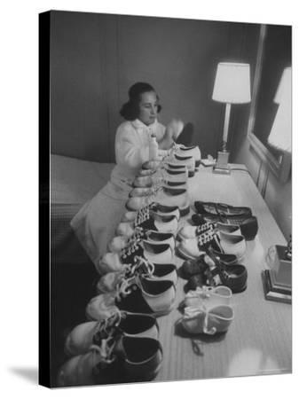 Mrs. Ottilie King Lining Up Her Children's Shoes-Stan Wayman-Stretched Canvas Print