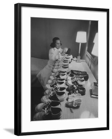 Mrs. Ottilie King Lining Up Her Children's Shoes-Stan Wayman-Framed Premium Photographic Print