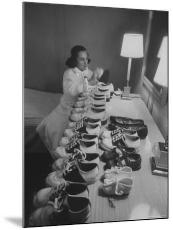 Mrs. Ottilie King Lining Up Her Children's Shoes-Stan Wayman-Mounted Photographic Print