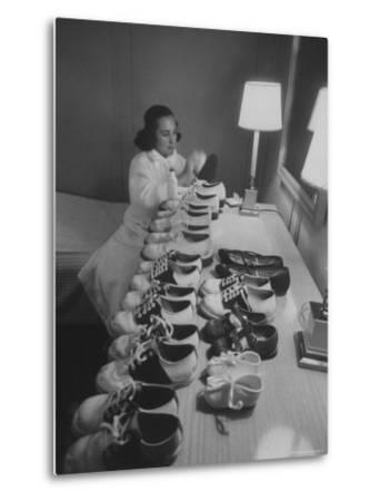 Mrs. Ottilie King Lining Up Her Children's Shoes-Stan Wayman-Metal Print
