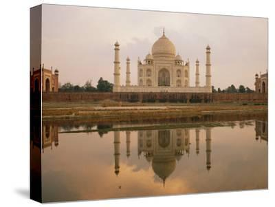A View of the Taj Mahal Reflected in the Yamuna River-Bill Ellzey-Stretched Canvas Print
