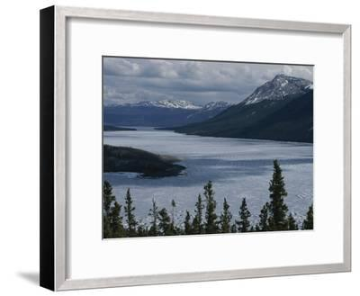 Snow-Capped Moutains Rise Above a Frozen Waterway on Kodiak Island-George F^ Mobley-Framed Photographic Print