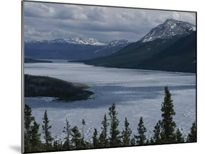 Snow-Capped Moutains Rise Above a Frozen Waterway on Kodiak Island-George F^ Mobley-Mounted Photographic Print