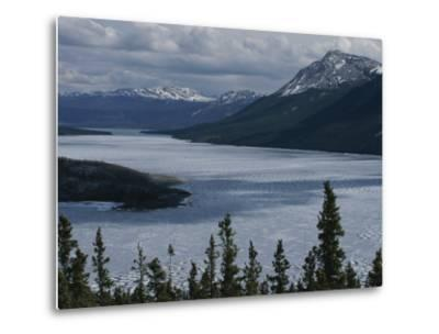 Snow-Capped Moutains Rise Above a Frozen Waterway on Kodiak Island-George F^ Mobley-Metal Print