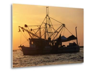 A Shrimp Boat Silhouetted against an Orange Sky--Metal Print