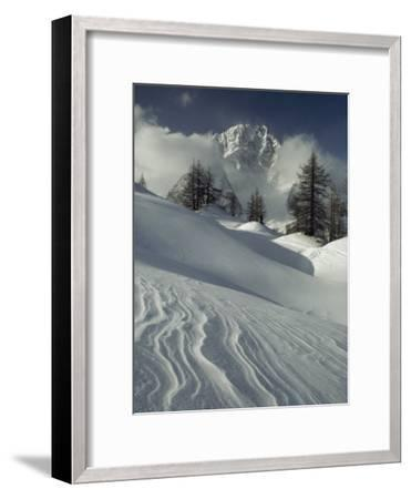 Mount Blanc Partially Obscured by Clouds in Snowy Landscape-Gordon Wiltsie-Framed Photographic Print