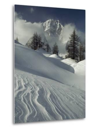 Mount Blanc Partially Obscured by Clouds in Snowy Landscape-Gordon Wiltsie-Metal Print