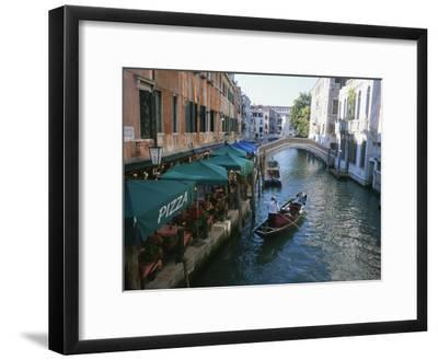 A Gondolier Passes a Restaurant on a Canal in Venice, Italy-Taylor S^ Kennedy-Framed Photographic Print
