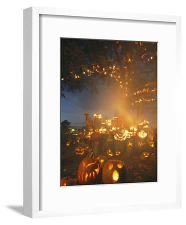 Grinning Lit Jack-O-Lanterns Surrounding and Filling a Tree-Richard Nowitz-Framed Photographic Print