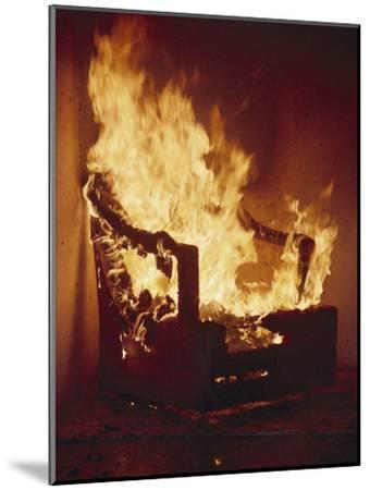 A Chair Set on Fire During a Flamability Test-Richard Nowitz-Mounted Photographic Print