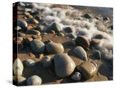 Water Washes up on Smooth Stones Lining a Beach-Michael S^ Lewis-Stretched Canvas Print