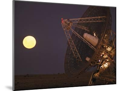 The Full Moon Rises Near a Satellite Dish-Joe Scherschel-Mounted Photographic Print