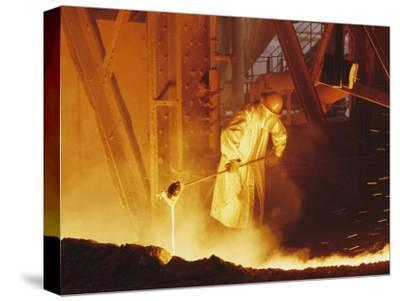 View of a Steel Worker Working in Protective Clothing-Joe Scherschel-Stretched Canvas Print