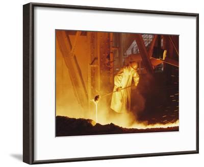 View of a Steel Worker Working in Protective Clothing-Joe Scherschel-Framed Photographic Print