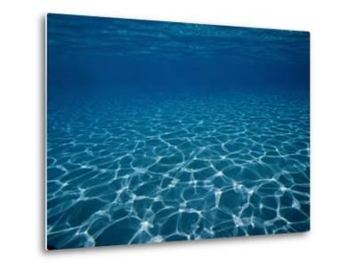Sunlight Reflects on the Sea Floor Through Crystal Clear Blue Water-Raul Touzon-Metal Print