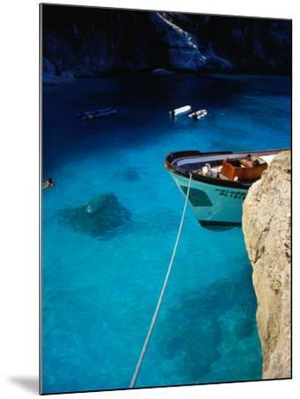Boat in Water of Cala De Mariolu, Golfo Di Orosei, Italy-Damien Simonis-Mounted Photographic Print
