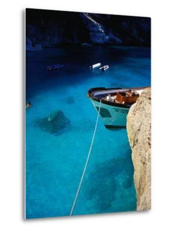 Boat in Water of Cala De Mariolu, Golfo Di Orosei, Italy-Damien Simonis-Metal Print