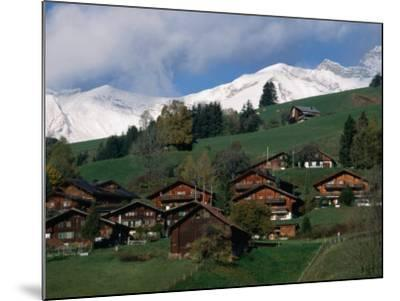 Wooden Chalets on Slope with Snow-Capped Peaks in the Background, Rougemont, Switzerland-Martin Moos-Mounted Photographic Print