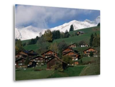 Wooden Chalets on Slope with Snow-Capped Peaks in the Background, Rougemont, Switzerland-Martin Moos-Metal Print
