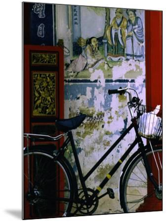 Bicycle Against Muralled Wall of Chinese Temple at Marudi, Sarawak, Malaysia-Mark Daffey-Mounted Photographic Print