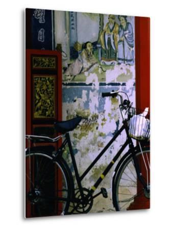 Bicycle Against Muralled Wall of Chinese Temple at Marudi, Sarawak, Malaysia-Mark Daffey-Metal Print