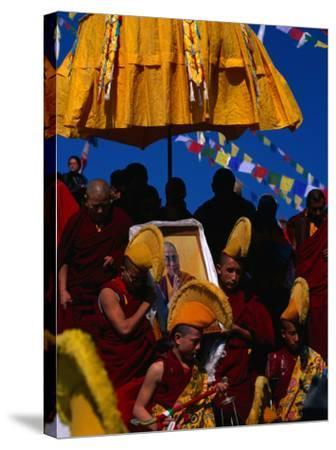 Tibetan Lamas Carrying Photo of Dalai Lama During Tibetan New Years Festival, Nepal-Kraig Lieb-Stretched Canvas Print