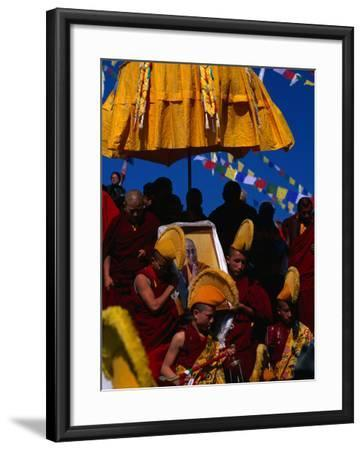 Tibetan Lamas Carrying Photo of Dalai Lama During Tibetan New Years Festival, Nepal-Kraig Lieb-Framed Photographic Print