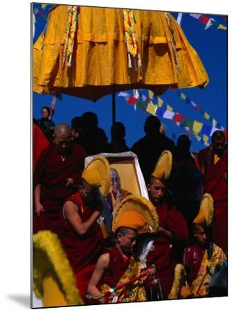 Tibetan Lamas Carrying Photo of Dalai Lama During Tibetan New Years Festival, Nepal-Kraig Lieb-Mounted Photographic Print