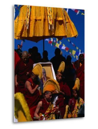 Tibetan Lamas Carrying Photo of Dalai Lama During Tibetan New Years Festival, Nepal-Kraig Lieb-Metal Print