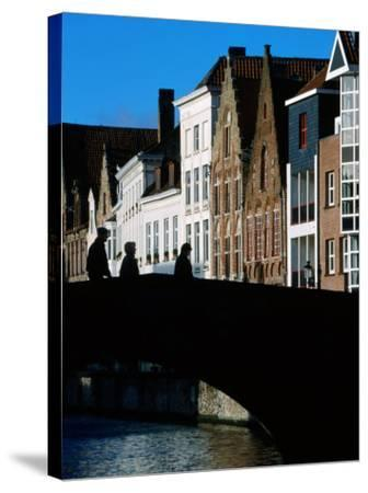 Pedestrians Crossing Canal and Houses Near Jan Van Eyckplein, Bruges, Belgium-Martin Moos-Stretched Canvas Print