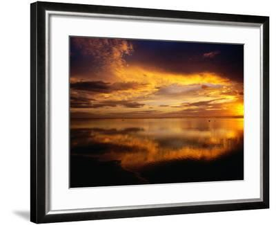 The Setting Sun Casts Light on Dark Clouds and Sea, Cook Islands-Peter Hendrie-Framed Photographic Print