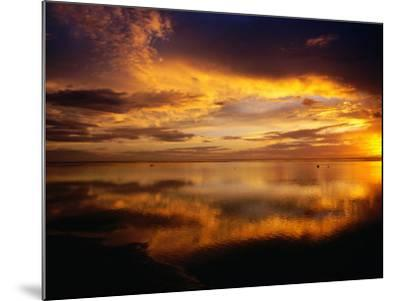 The Setting Sun Casts Light on Dark Clouds and Sea, Cook Islands-Peter Hendrie-Mounted Photographic Print