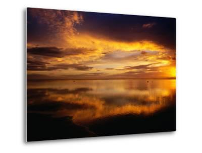 The Setting Sun Casts Light on Dark Clouds and Sea, Cook Islands-Peter Hendrie-Metal Print