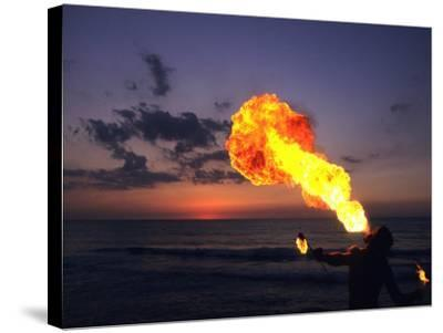 Fireeater at Sunset, Jamaica-Holger Leue-Stretched Canvas Print