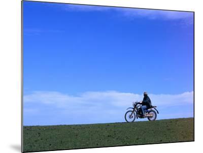 Local Farmer Riding Motorbike Across Paddock, Seymour, Australia-Will Salter-Mounted Photographic Print