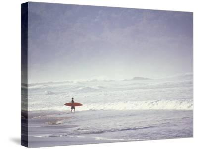 Cocoa Beach Surfer, Florida, USA-Stuart Westmoreland-Stretched Canvas Print
