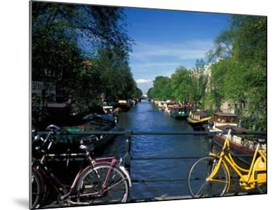 Yellow Bicycle and Canal, Amsterdam, Netherlands-Nik Wheeler-Mounted Photographic Print