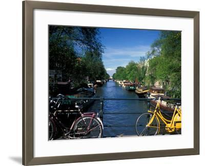 Yellow Bicycle and Canal, Amsterdam, Netherlands-Nik Wheeler-Framed Photographic Print