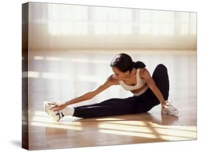 Brunette Stretching--Stretched Canvas Print