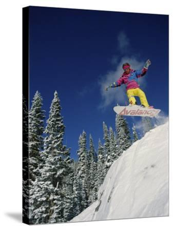 Airborne Snowboarder--Stretched Canvas Print