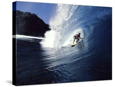 Surfer Riding a Wave--Stretched Canvas Print