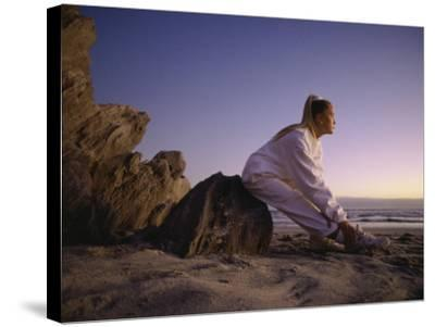Young Woman Exercising on the Beach--Stretched Canvas Print