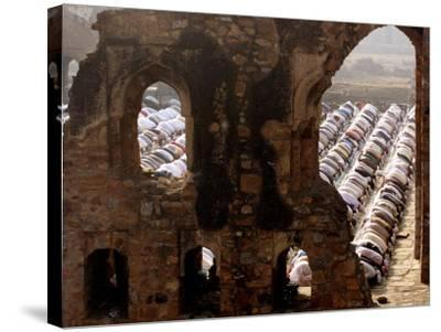 Muslims Offer Eid Prayers at the Ruins of Jami Mosque, Which was Built in 1345 AD-Manish Swarup-Stretched Canvas Print