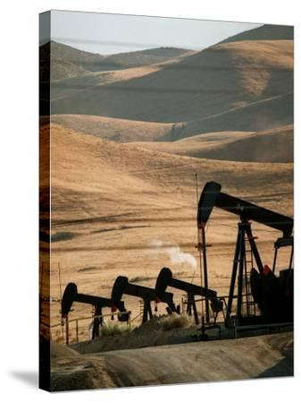 Oil Pumps Work the Midway Sunset Oil Field West of Taft, Calif.--Stretched Canvas Print