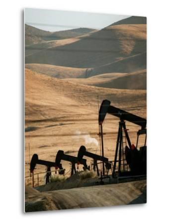 Oil Pumps Work the Midway Sunset Oil Field West of Taft, Calif.--Metal Print